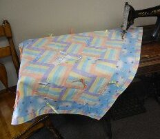 Unisex baby/toddler quilt in pastel rail fence pattern hand-tied.